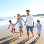 Family having fun running on the beach — Stock Photo