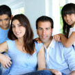 Stock Photo: Family relaxing in sofat home