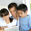 Father and kids websurfing on digital tablet — Stock Photo #13937266
