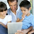 Father and kids websurfing on digital tablet — Stock Photo #13937267