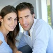 Closeup of cheerful couple sitting in sofa — Stock Photo #13937272