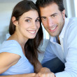 Closeup of cheerful couple sitting in sofa - Stok fotoğraf