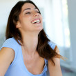 Beautiful brunette girl laughing outloud — Stock Photo #13937331