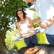 Couple cooking meat on barbecue grill — Stock Photo