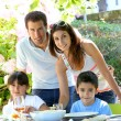 Closeup of happy family having lunch in garden — Stock Photo