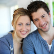 Closeup of cheerful young couple wearing blue — Stock Photo