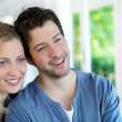 Closeup of cheerful young couple wearing blue — Stock Photo #13938285