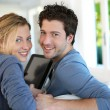 Young couple using electronic tablet — Stock Photo