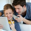 Young couple at home buying on internet - Stok fotoraf