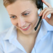 Closeup of attractive blond customer service assistant — Stock Photo #13938416