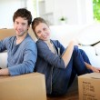 Young couple moving in their home — Stock Photo #13938424