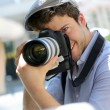 Photographer taking picture of woman model — Stock Photo