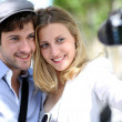 Young couple taking picture of each other — Stock Photo