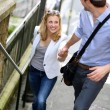 Young romantic couple climbing stairs in town — Stock Photo #13938659