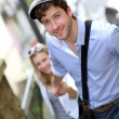 Stock Photo: Young romantic couple climbing stairs in town