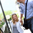Young romantic couple climbing stairs in town — Stock Photo #13938669