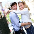 Stock Photo: Young in love couple embracing each other in town