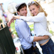 Young in love couple embracing each other in town — Stock Photo