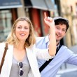 Young couple hailing for a taxi cab — Stock Photo #13938711