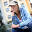 Streetwear woman sitting in the street — Stock Photo