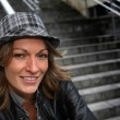 Portrait of woman with hat and leather jacket in town — Stock Photo #13939111