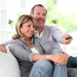 Senior couple watching television at home — Stock Photo