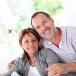 Cheerful senior couple enjoying being at home — Stock Photo