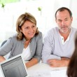 Senior couple ready to buy new house reading contract — Stock Photo #13939907