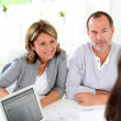 Stock Photo: Senior couple ready to buy new house reading contract
