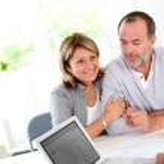 Senior couple ready to buy new house reading contract — Stock Photo #13939908
