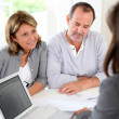 Senior couple ready to buy new house reading contract — Stock Photo #13939909