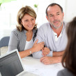 Senior couple ready to buy new house reading contract - Foto de Stock