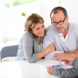 Senior couple signing financial contract — Stock Photo