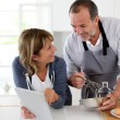 Senior couple having fun in home kitchen — Stock Photo #13939956