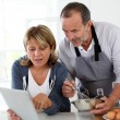 Senior couple having fun in home kitchen — Stock Photo #13939957
