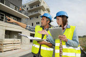Engineers working on construction site — Stock Photo