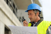 Portrait of construction manager using walkie-talkie — Stock Photo