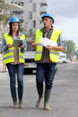 Construction walking on building site — Stock Photo