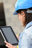 Back view of woman architect using electronic tablet — Stock Photo