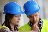 Closeup of construction with blue security helmet — Stock Photo