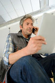 Construction manager using mobile phone on building site — Stock Photo