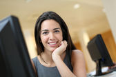 Smiling office worker at ther desk — Stock Photo
