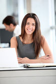 Attractive businesswoman working on laptop computer — Stock Photo