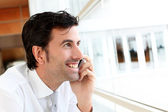 Portrait of businessman talking on mobile phone — Stock Photo