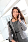 Smiling businesswoman talking on the phone — Stock Photo