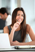 Young woman working in office — Stock Photo