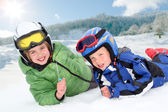 Portrait of children in ski outfit at the mountain — Stock Photo