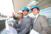 Construction engineers checking building site — Stock Photo