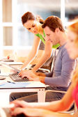 Group of young working on computer — Stock Photo