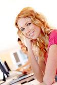 Beautiful blond girl working on laptop computer — Stock Photo
